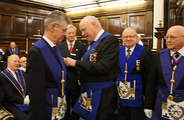 After receiving his own Jewel from Sir Paul, the PGM reciprocates.
