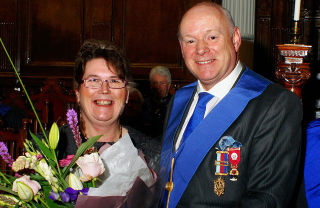 Manager of the AEPOWC Mrs Alyson Owen-Neill receives a bouquet from the PGM at Hendre Lodge.