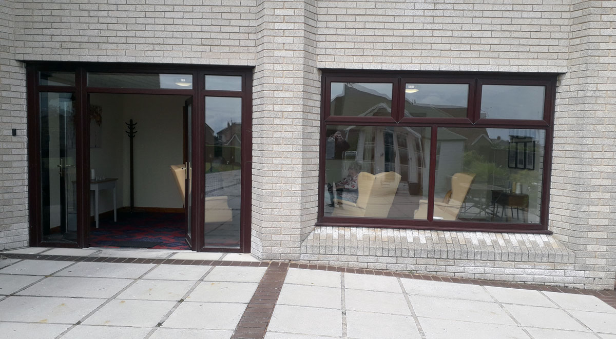 AEPWC – COVID-19 relatives' entrance on the left & residents room window on the right